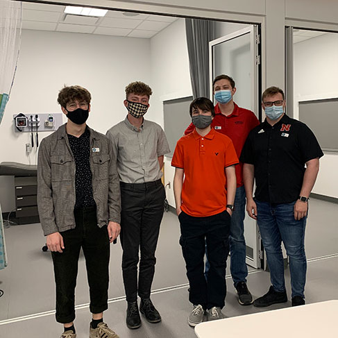 Photo of the Agriculture Safety & Health VR standing in front of a medical exam room