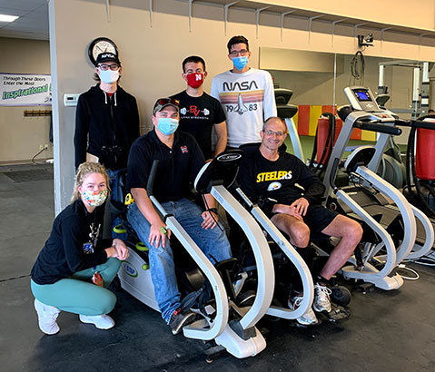 Cardio Access Machine team posing for a picture inside a gym.