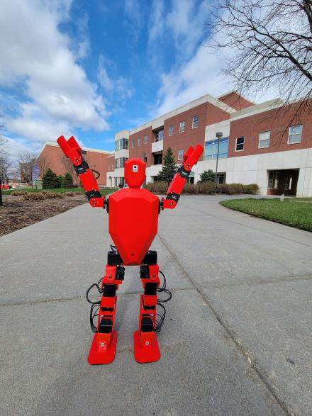 Photo of the The Bipedal Robot standing in front of Othmer Hall