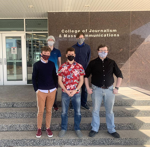 Photo of the UNMC Escape VR Team standing in front of the College of Journalism and Mass Communications entrance