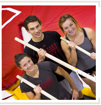 Article Link: Soaring to new heights. Image of Biological Systems Engineering Majors Paula Andrie, Steven Cahoy and Karlye Cygan are pole vaulters for the UNL Track and Field teams.