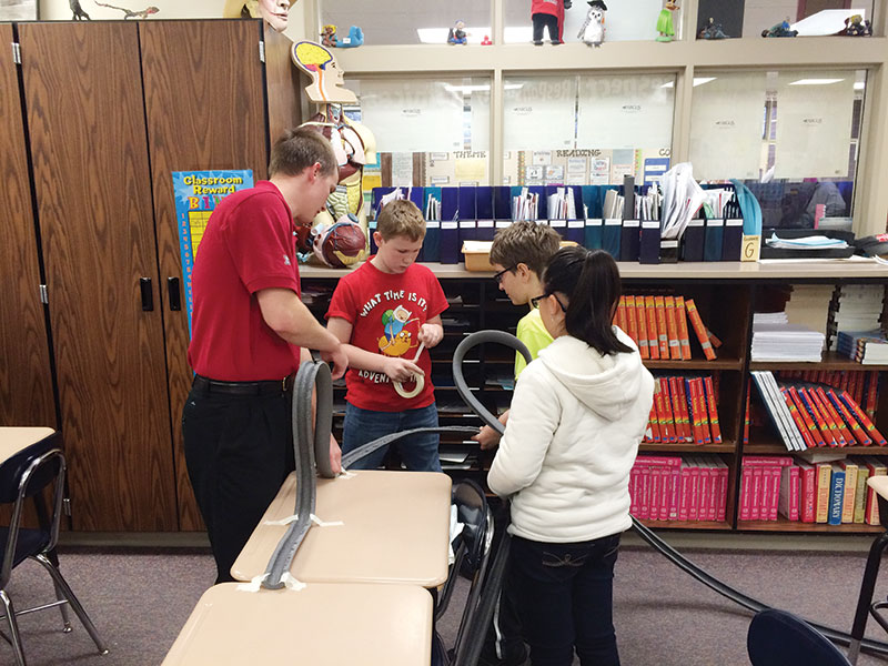Elementary Students and Ambassadors do a project working with a roller coaster