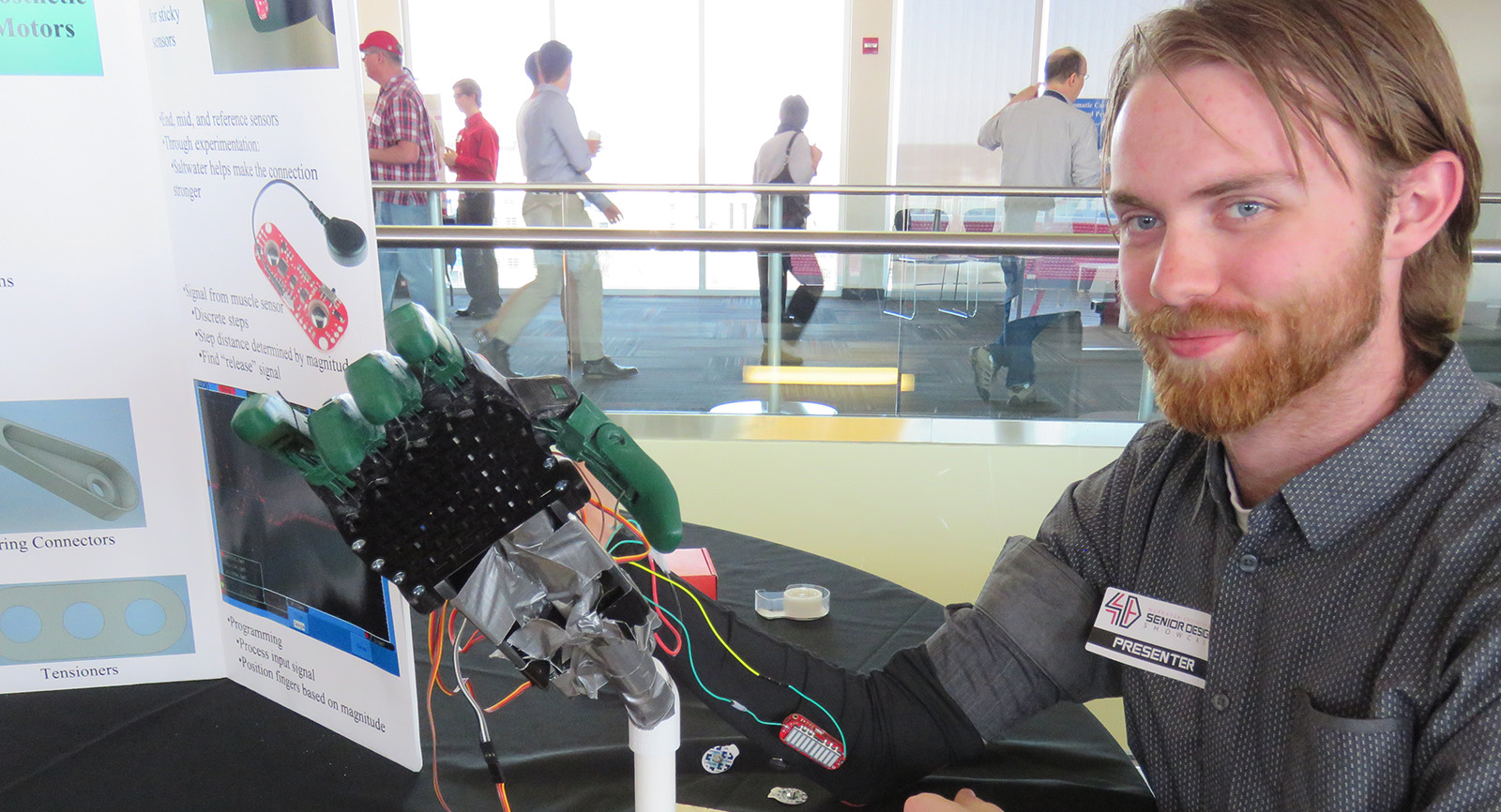 Student shows mechanical hand for senior design project