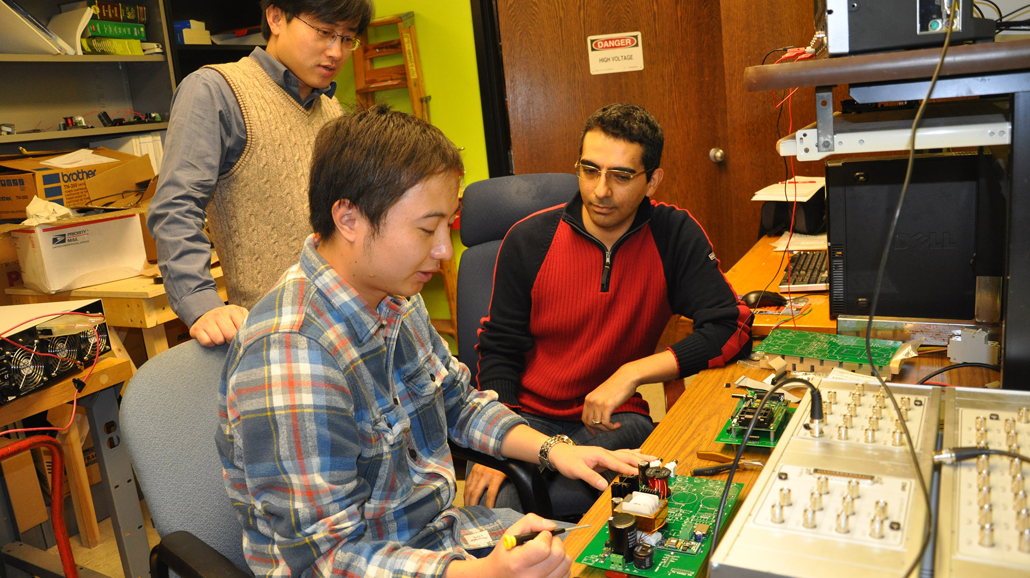 students with a circuit board