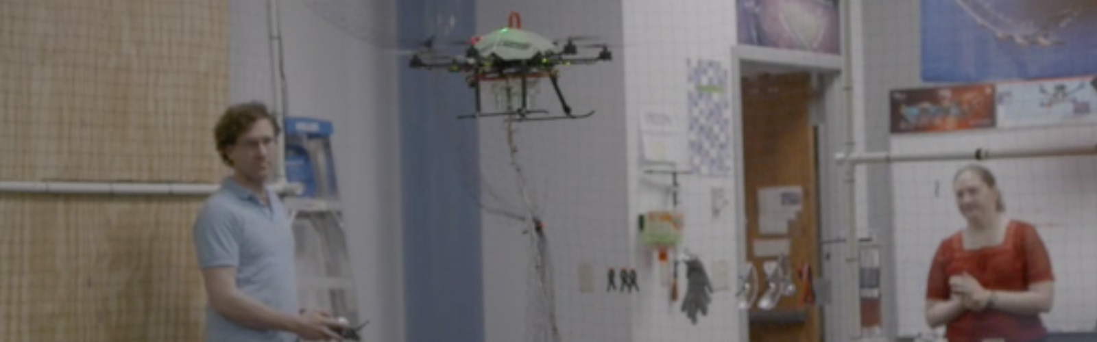 Members of the Drone Lab flying a drone inside the facility.