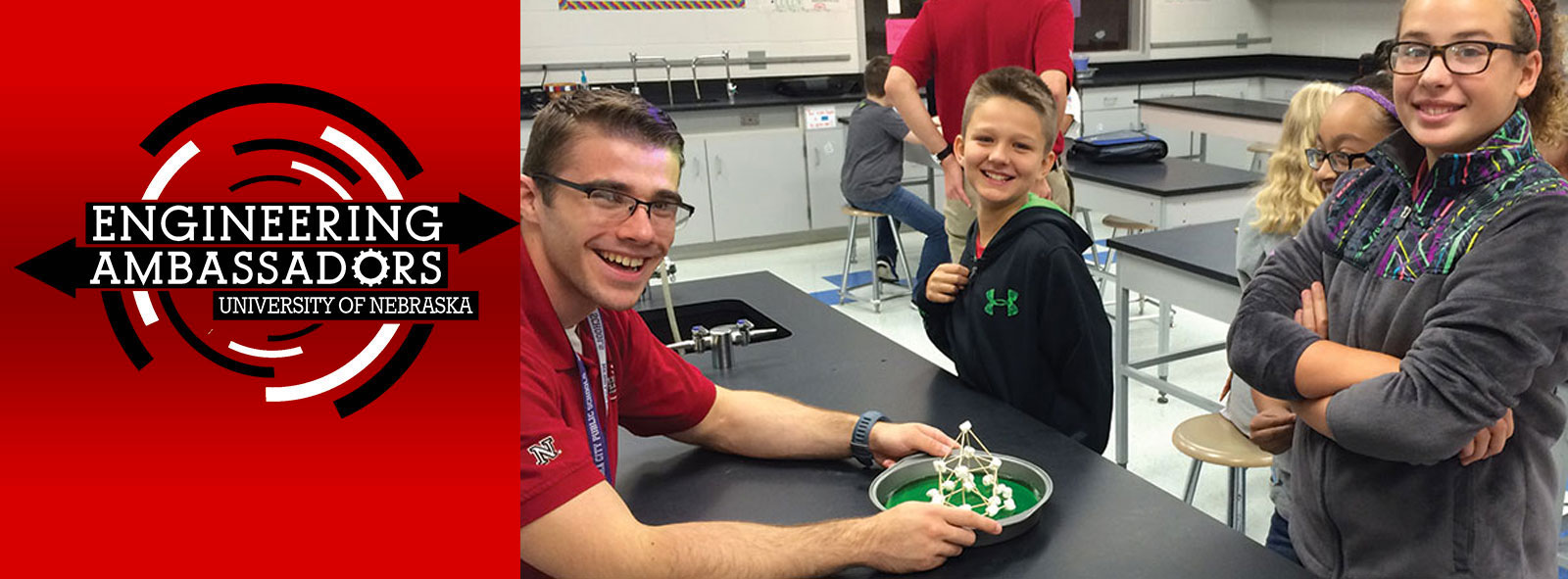 Engineering Ambassador and students work with earthquake structures.