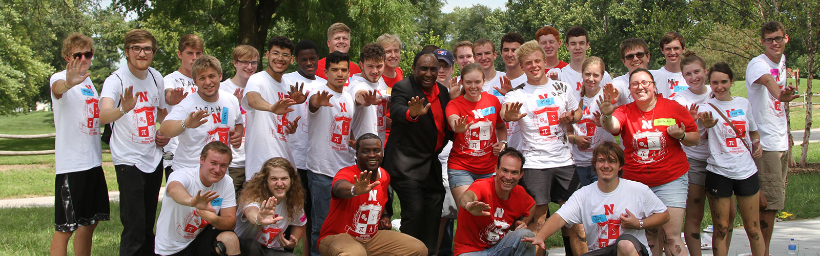 ERA 2019 Group giving a Heisman pose with 1972 Heisman award winner Johnny Rodgers.