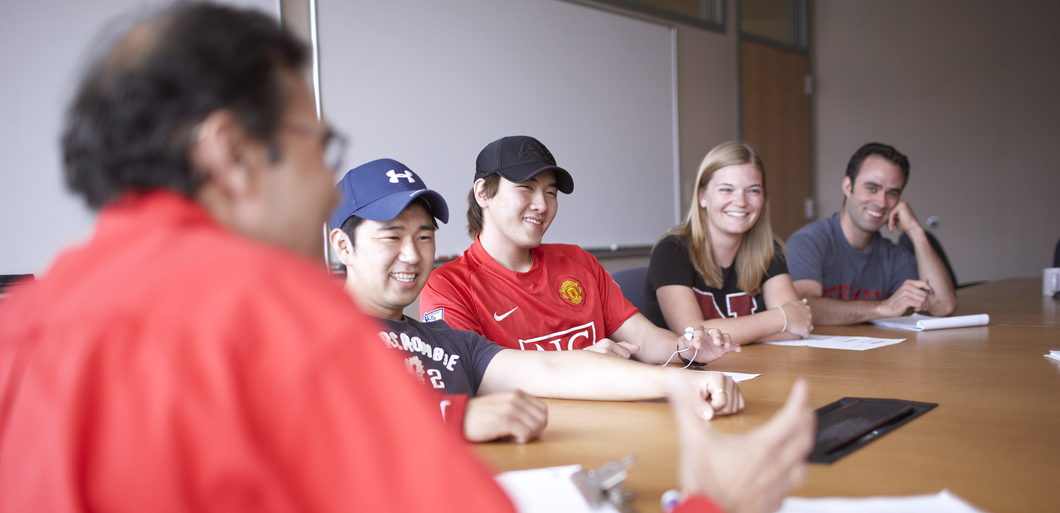Faculty with smiling students