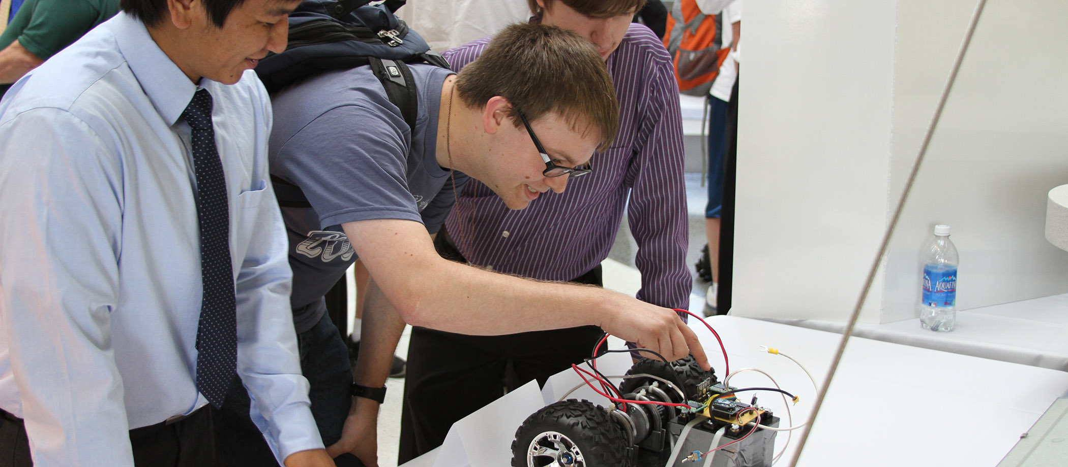 students looking at a CEENBoT