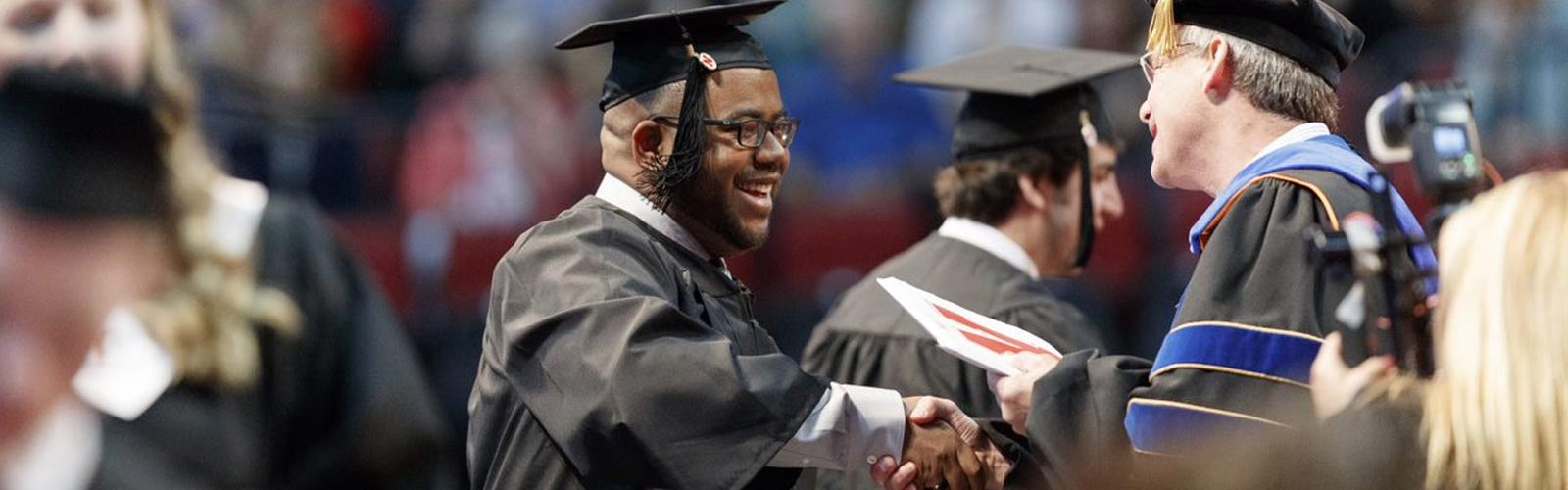 Student receiving degree at graduation.