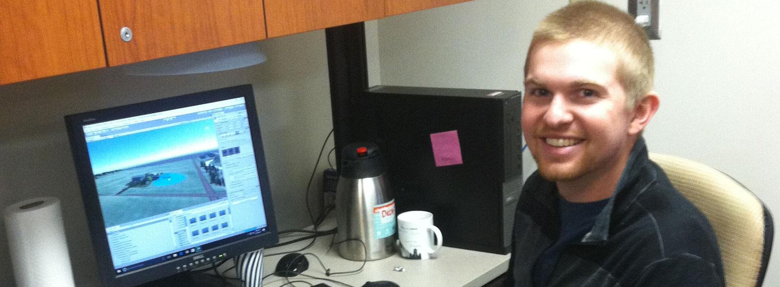 Nathan Rice sitting at a computer