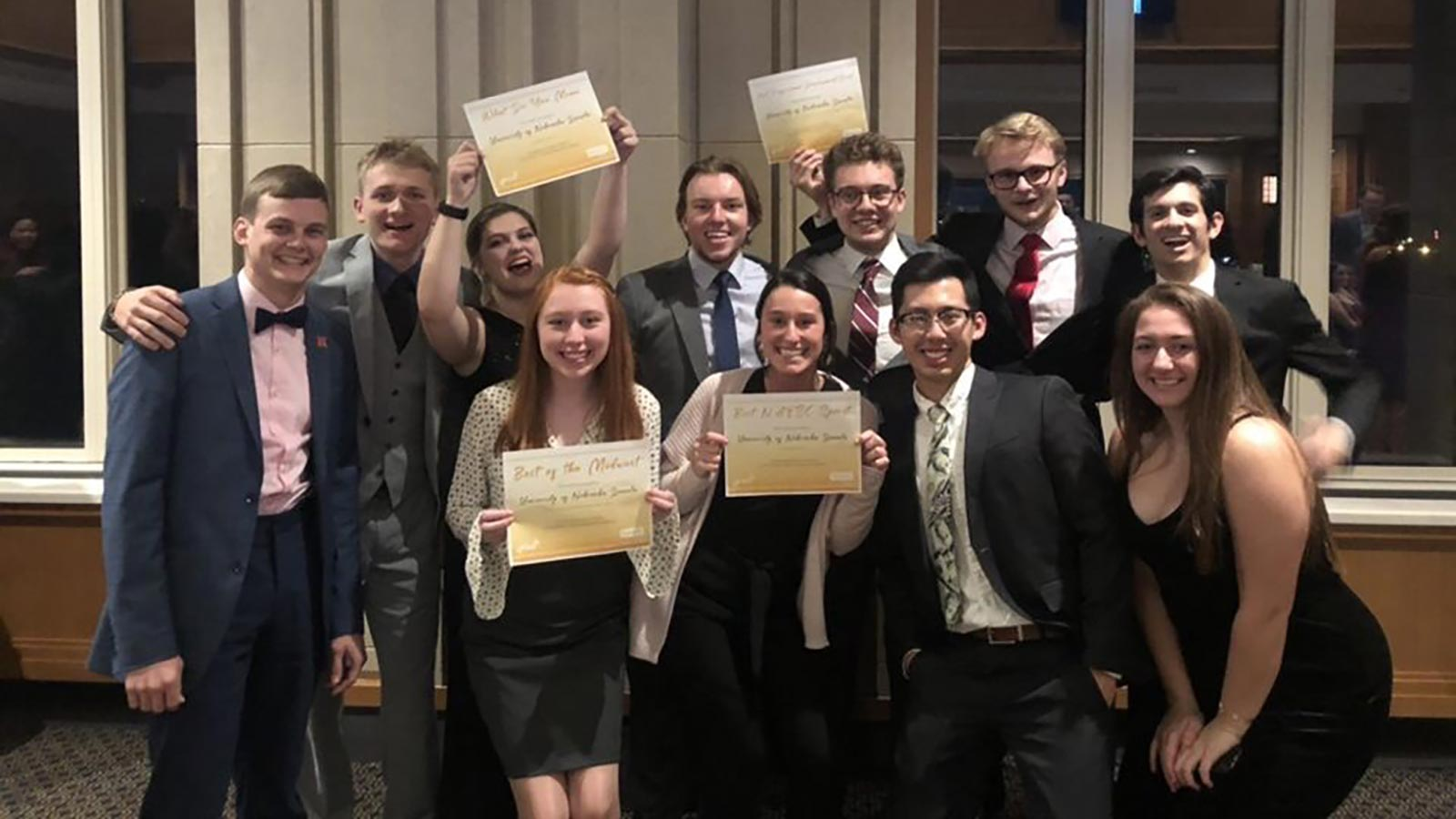 """Sidney Matthias and a group of engineering friends show off their """"Best of the Midwest"""" awards."""