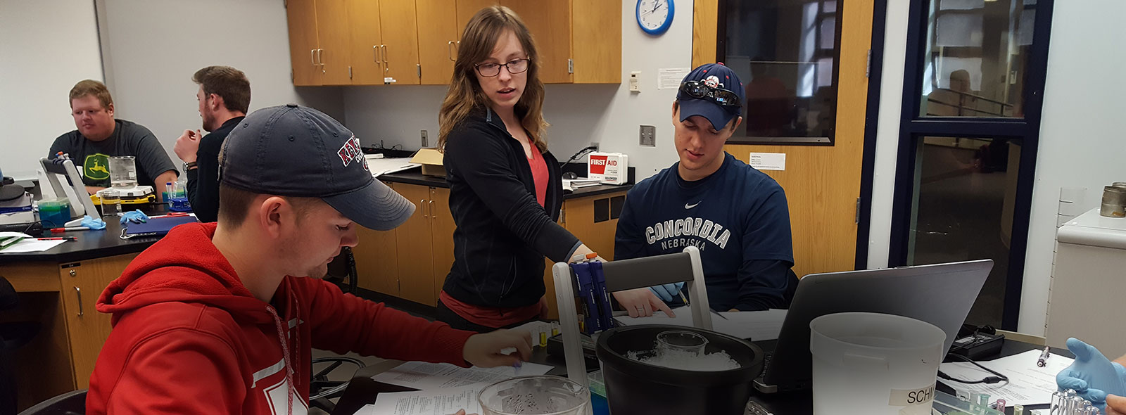 Ellen Emanuel working with students in a lab