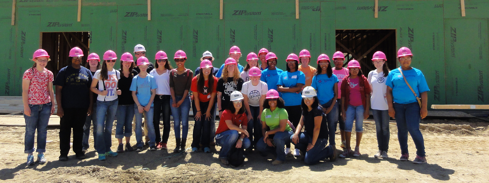 Durham School Pink Hardhat Program - Students lining up for a photo