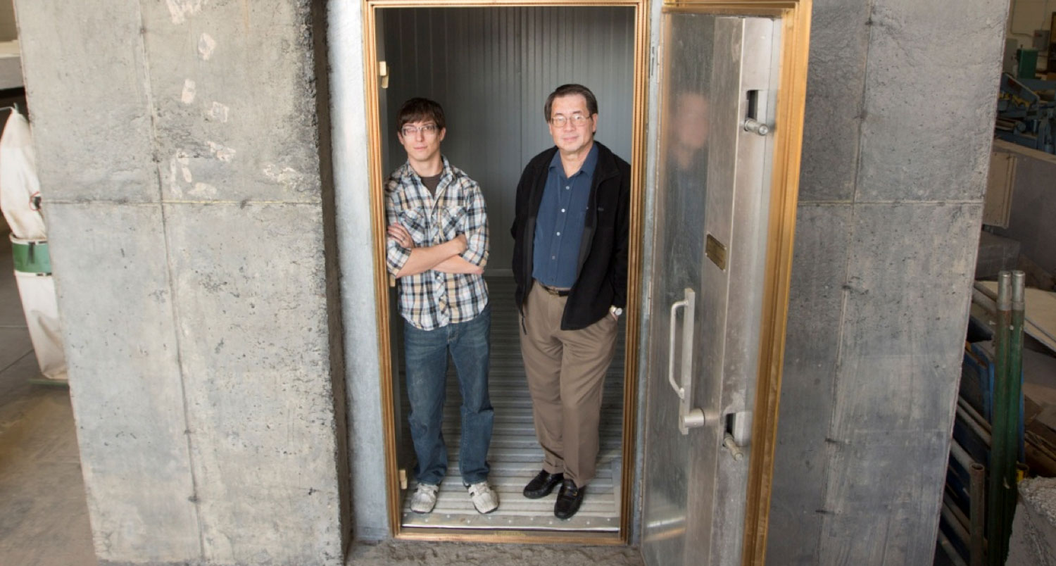 Structural engineering professor Chris Tuan and graduate student Adam Sevenker stood in a conductive concrete shelter build for a Department of Defense project.
