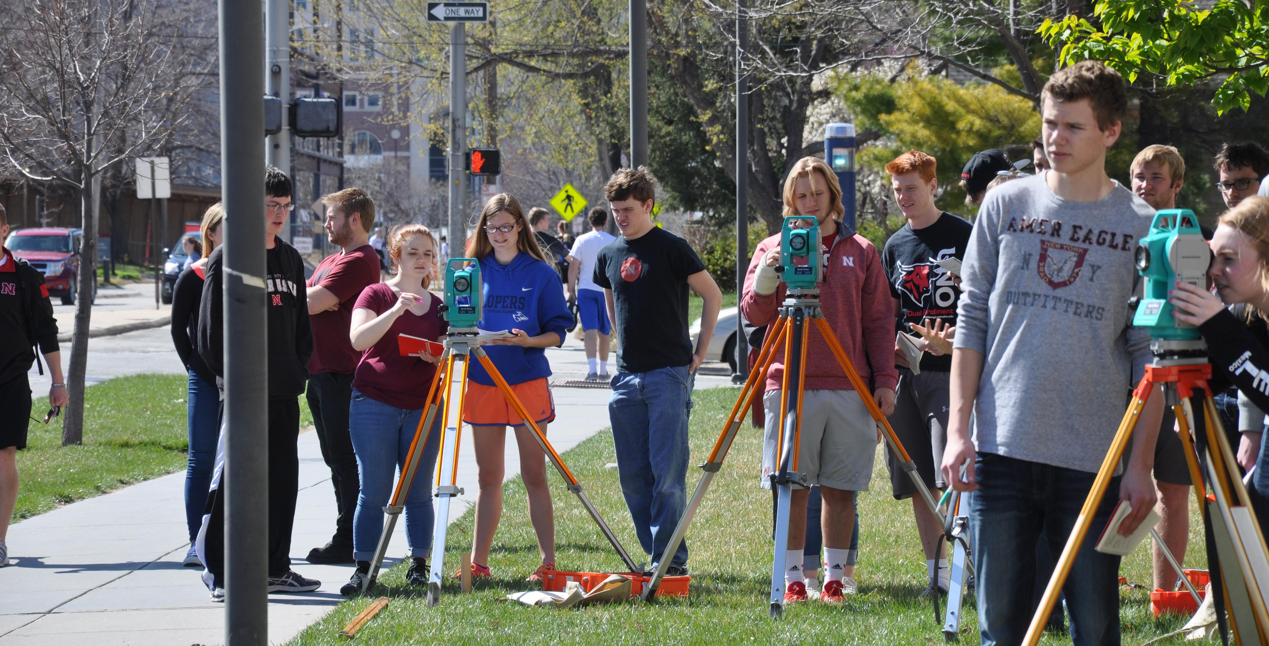 Surveying outside Othmer Hall
