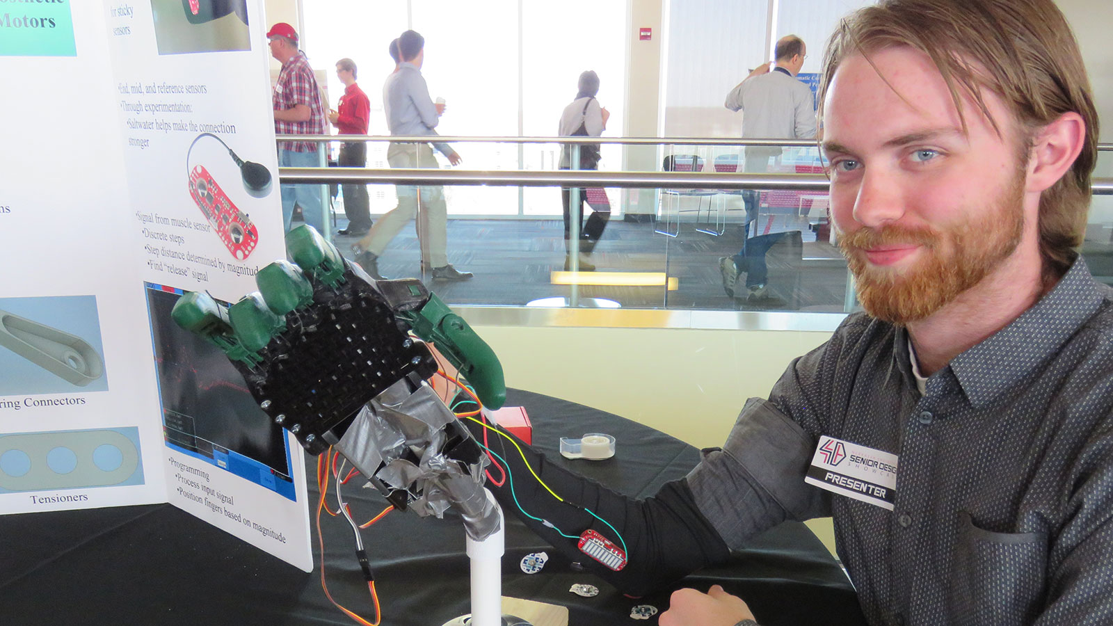 Student working with a robotic hand.