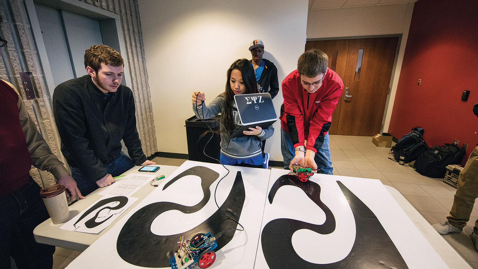 Students in computer science, computer engineering and software engineering build and program robotics for hands-on learning.
