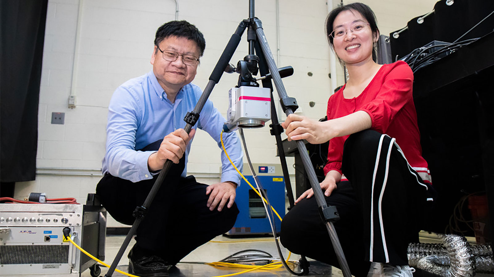 Nebraska's Yongfeng Lu (left) and doctoral student Lei Liu with a portable laser that helps prevent and repair corrosion on aluminum-sided ships.