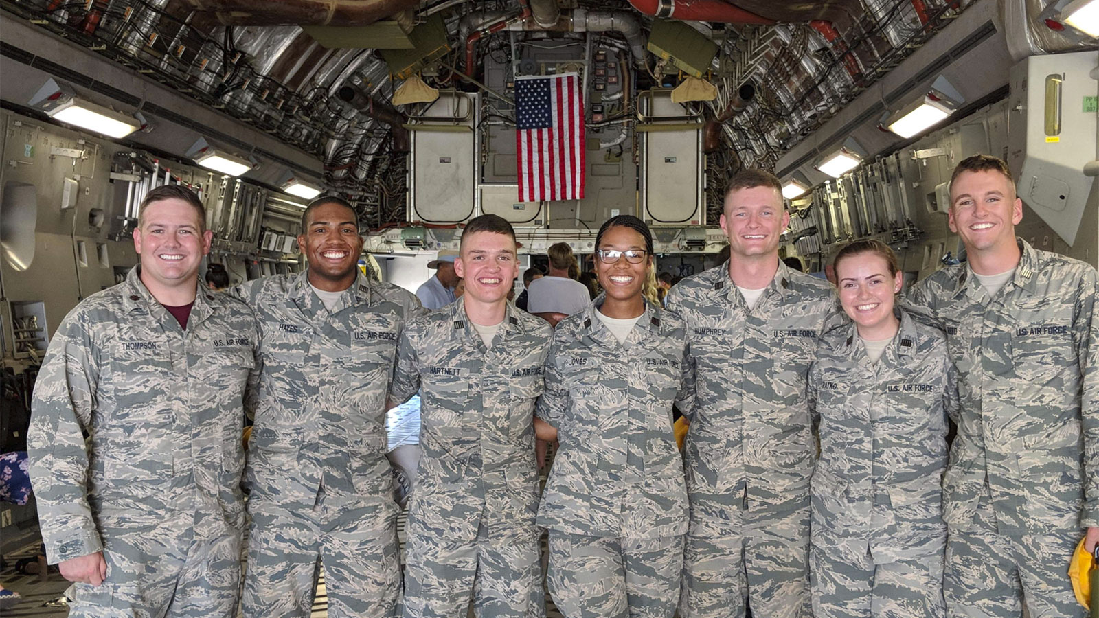 Major Justin Humphrey and his fellow ROTC cadets pose for a photo inside a military plane.