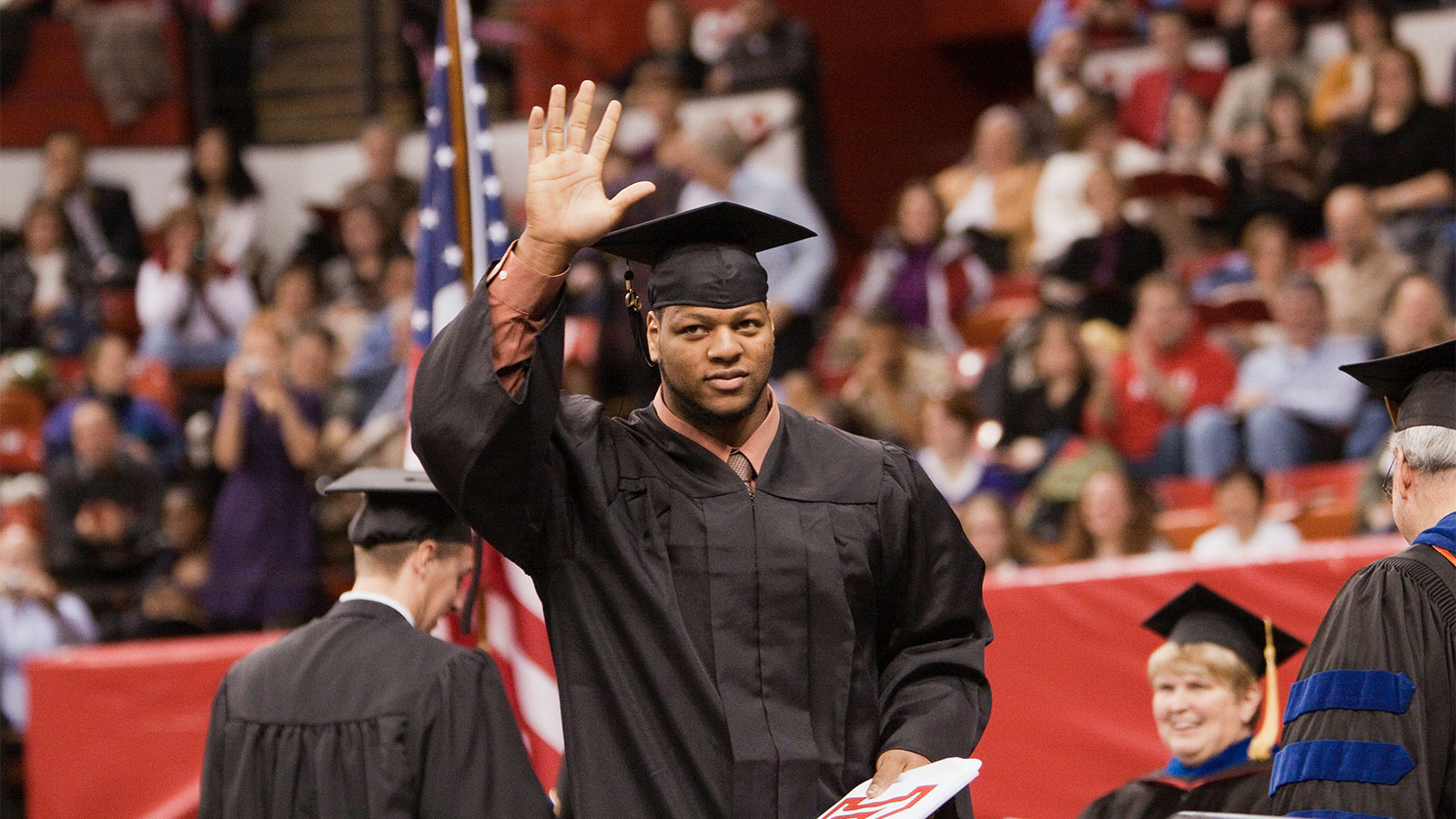 College of Engineering alumni Ndamukong Suh receives his diploma from the University of Nebraska-Lincoln.