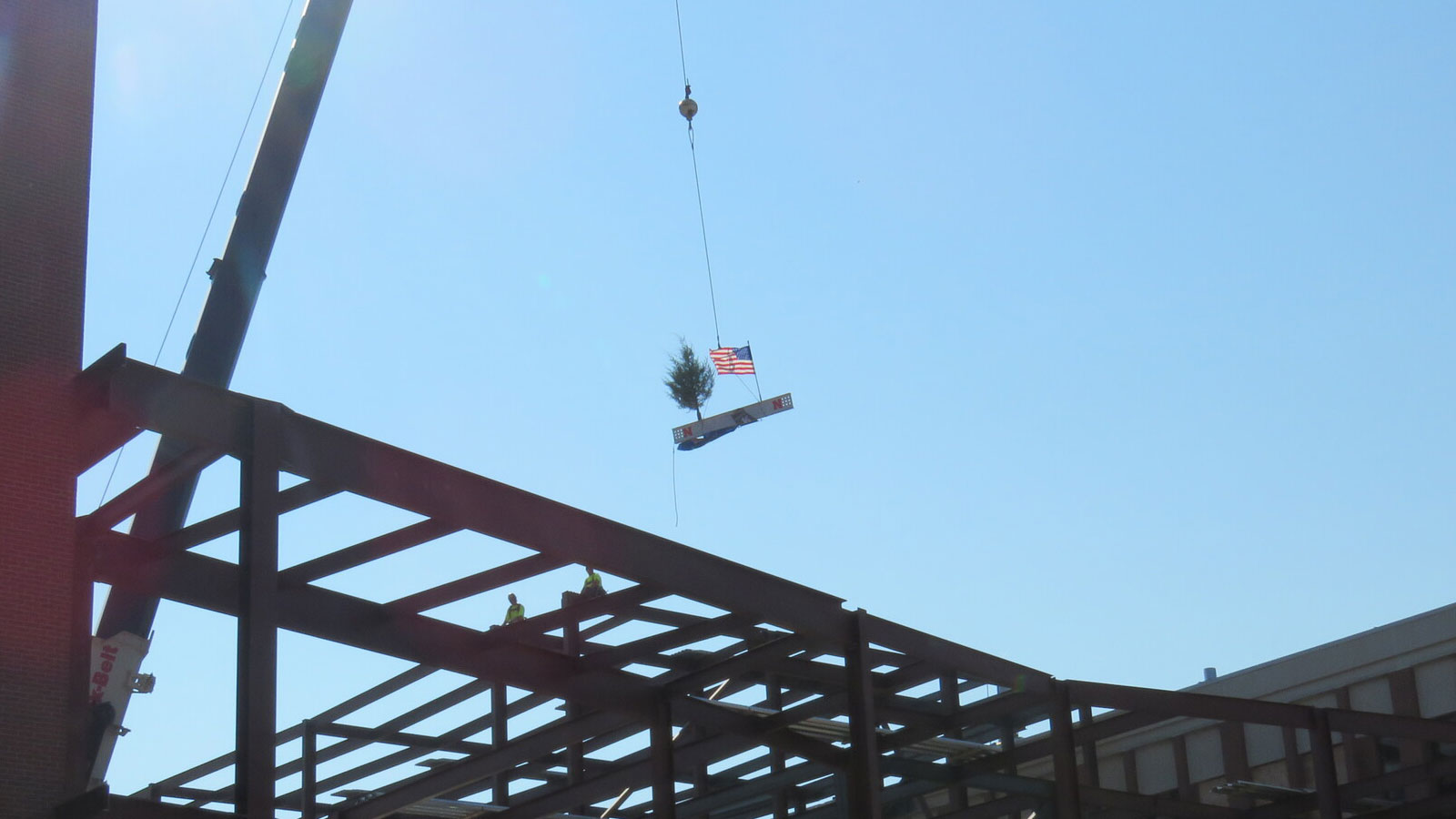 The final topping off beam is being lowered into place on the new Link/Scott Engineering Center addition.