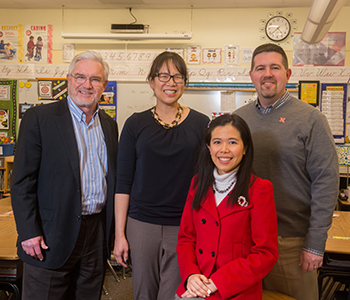 Three UNL Architectural Engineering faculty – (from left) professors Clarence Waters and Lily Wang and assistant professor Josephine Lau – are teaming with Jim Bovaird (right), associate professor of educational psychology, on a four-year EPA grant to study indoor environmental factors and their effects on the scholastic achievement of students from kindergarten through 12th grade. (Photo by Greg Nathan, University Communications)