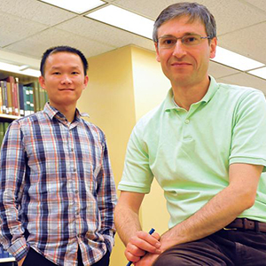 Research by UNL's (from left) Ziguang Chen and Florin Bobaru has led to the creation of a new model that better predicts the effects of corrosion. The study was published in the Feb. 27 online edition of the Journal of the Mechanics and Physics of Solids. Photo by Scott Schrage | University Communications