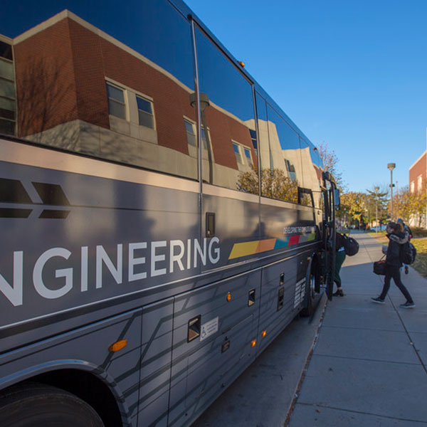 Riders get on the N-E Ride shuttle outside Othmer Hall on the morning of Nov. 16. The weekday shuttle, which started in 2014, is primarily used to connect Nebraska Engineering's City (Lincoln) and Scott (Omaha) campuses. (Troy Fedderson / University Communication)