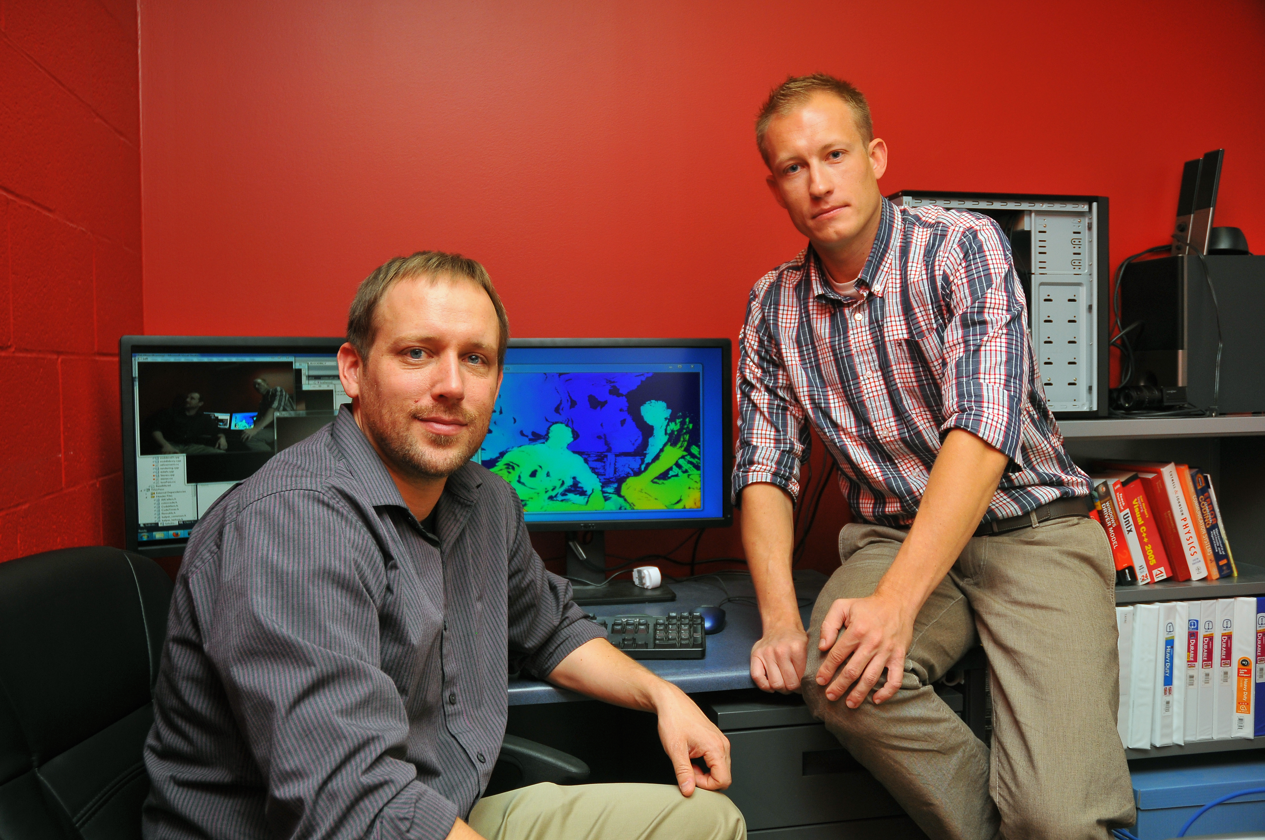 Eric Psota (left) and Jedrzej Kowalczuk (Photo by Troy Fedderson, University Communications)
