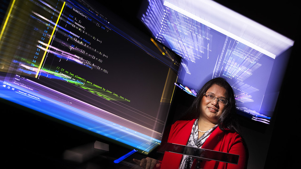 Bonita Sharif, assistant professor of computer science and engineering, is using eye-tracking technology to analyze how software programmers work in order to develop ways to write code better and faster.  (Craig Chandler / University Communication)