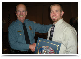 Allan Wickard receives a Citizen Meritorious Conduct Award from Chief Thomas K. Casady of LPD.