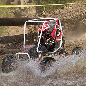 Driver Eric Rice pilots the Husker Racing Baja SAE car through a water crossing during an April competition in Cookeville, Tennessee. The team took fifth place at that event and competes this weekend in Gorman, California.