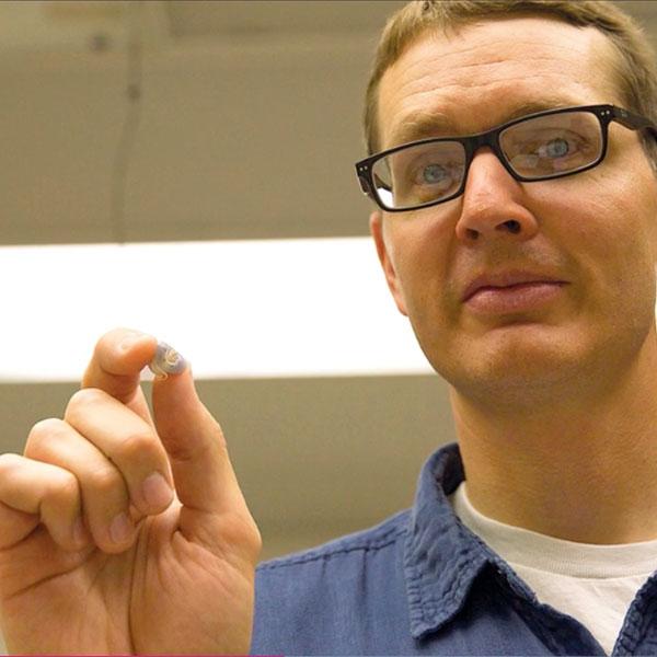 University of Nebraska Mechanical Engineering Professor Benjamin Terry holding an swallowable sensor