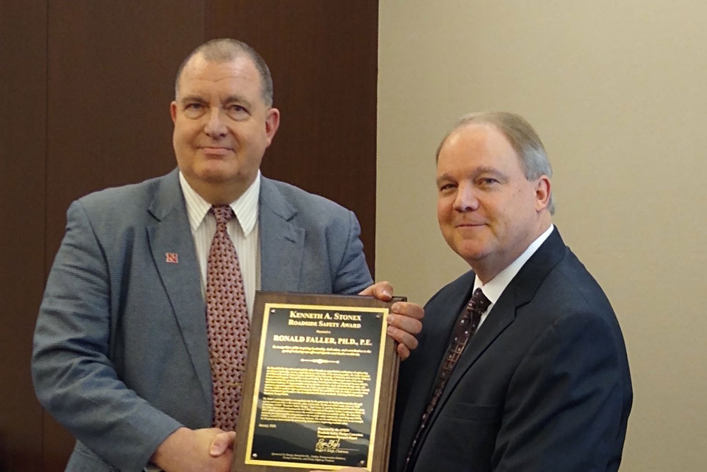 Ron Faller (left), director of the Midwest Roadside Safety Facility and research professor of Civil and Environmental Engineering, received the Kenneth A. Stonex Award for lifetime contributions to roadside safety during the 99th Annual Transportation Research Board meeting in Washington, D.C.