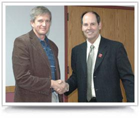 Hendrik Viljoen receives award from Dean David H. Allen.
