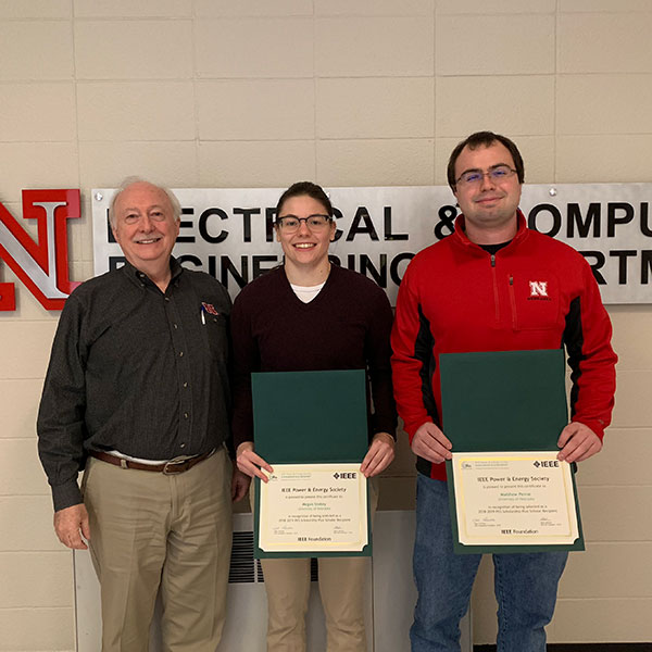 Jerry Hudgins (left), chair of electrical and computer engineering, presents students Megan Stokey (center) and Matthew Penne with their certificates for being chosen to receive the 2018-19 IEEE Power and Energy Society Scholarship Plus Initiative awards.