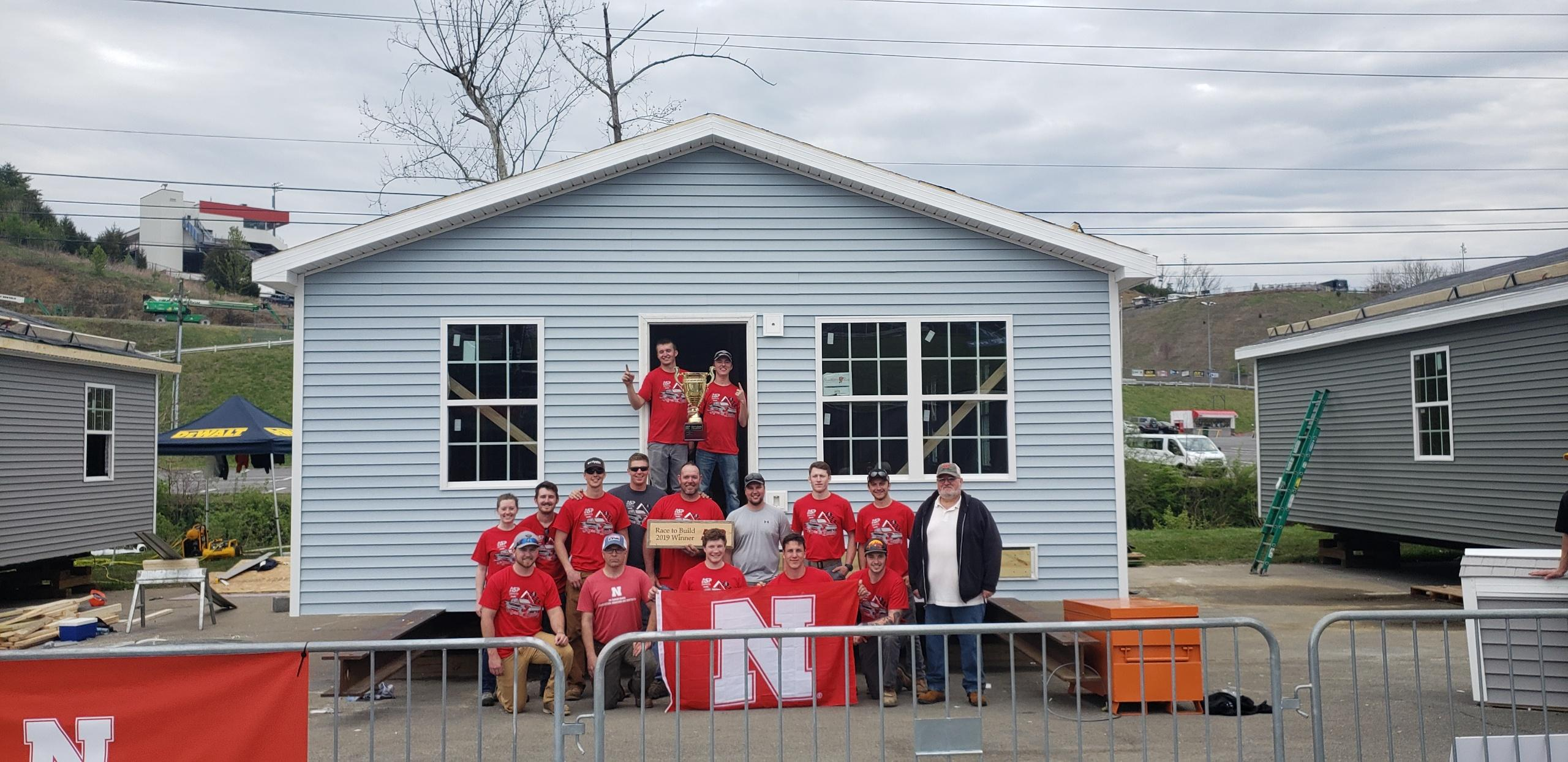 The Nebraska construction management team won the Race to Build competition, held April 5-7 in Bristol, Tennessee. Three teams of university students compete to build houses over three days. The houses are given to veteran families in that area.