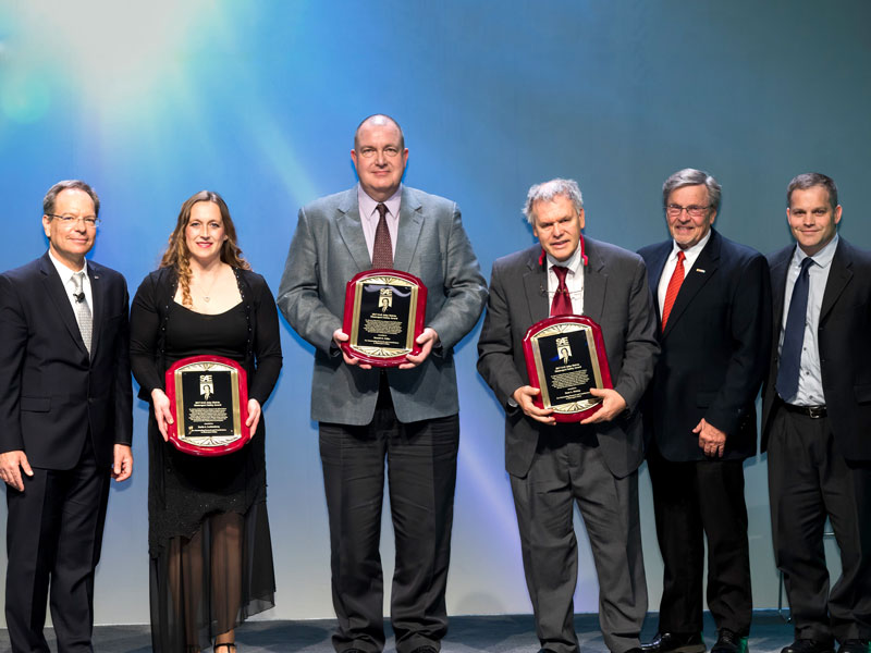 Members of SAE International present the John Melvin Motorsports Safety Award to Karla Lechtenberg, Ron Faller and Dean Sicking