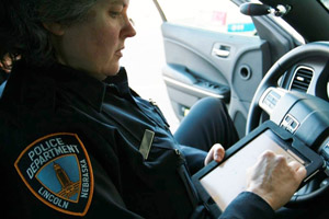 LPD Officer Mary Lingelbach uses CrimeView NEARme technology developed by UNL computer engineers.