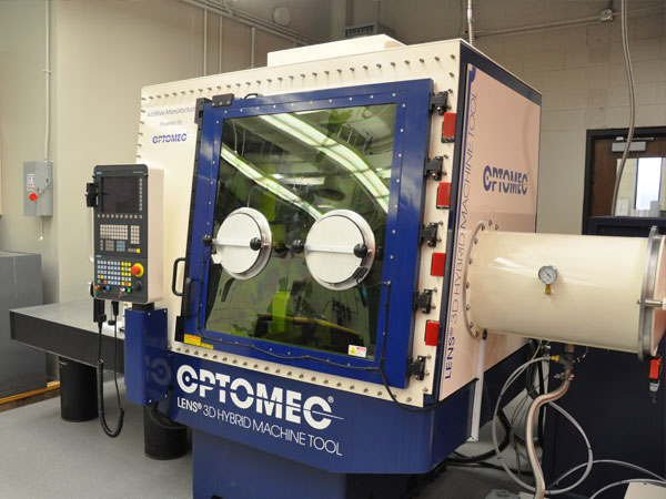 The Optomec Lens 3D Hybrid Machine Tool is one of three new hybrid 3-D printers installed in the new Nebraska Engineering Additive Technology (NEAT) Labs in Scott Engineering Center.