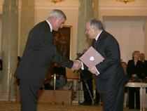 Professor Andrzej Nowak, left, receives his award from Poland President Lech Kaczynkski.