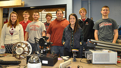 The UNL RASC-AL Robo-Ops team of engineering students must build a rover and remotely navigate it through obstacles in a NASA-sponsored competition versus other selected university teams' rovers. The team includes (from left): Allison Miller, Alex Adams, Eric Markvicka, Mark Reichenbach, Joe Bartels, Effie Greene, Lukas Renker and Kearney Lackas. Not pictured: Tom Frederick and Walter Bircher.