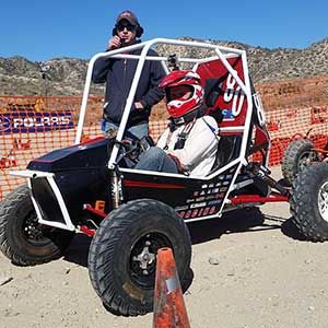 Husker Racing driver Eric Rice waits to take the No. 80 car out on the track at the Baja SAE Collegiate Design Series event in Gorman, California, last weekend.