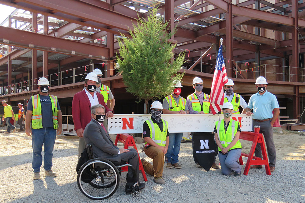 College of Engineering Dean Lance C. Pérez and representatives of Hausmann Construction were among the people who signed the final steel beam in the new Link before it was raised and put into place Wednesday, Aug. 26, 2020.
