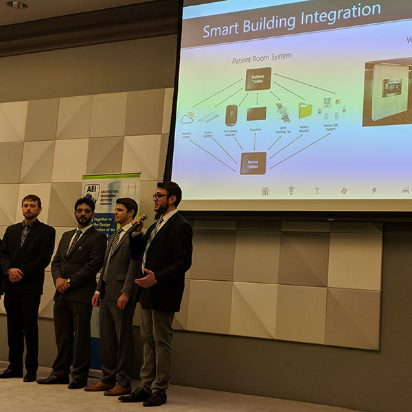 Cody Largent (right) discusses smart building integration as the Nebraska engineering team presents its proposal April 5 during the Architectural Engineering Institute (AEI) Forum Student Design Competition at Scott Conference Center in Omaha.