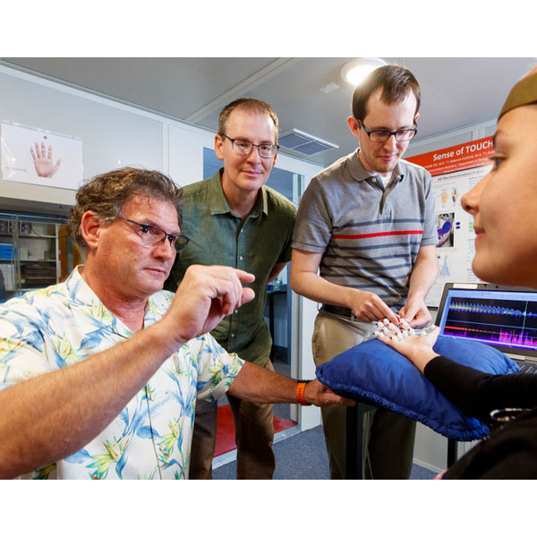 Nebraska researchers Steven Barlow, (near left) and Greg Bashford (center) have developed a system to treat stroke victims using a functional transcranial Doppler ultrasound and somatosensory stimulation. The technology could prevent brain death.