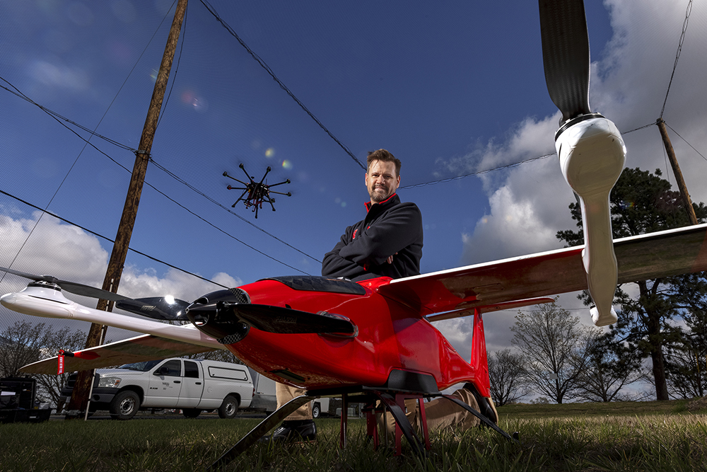 Justin Bradley, assistant professor of computer science and engineering at Nebraska, is using a nearly $500,000, five-year grant from the National Science Foundation's Faculty Early Career Development Program to give drones and other robots the ability to sense and adapt to a changing environment, diverting energy to the most important tasks at hand while pausing lower-priority work. (Craig Chandler / University Communication)