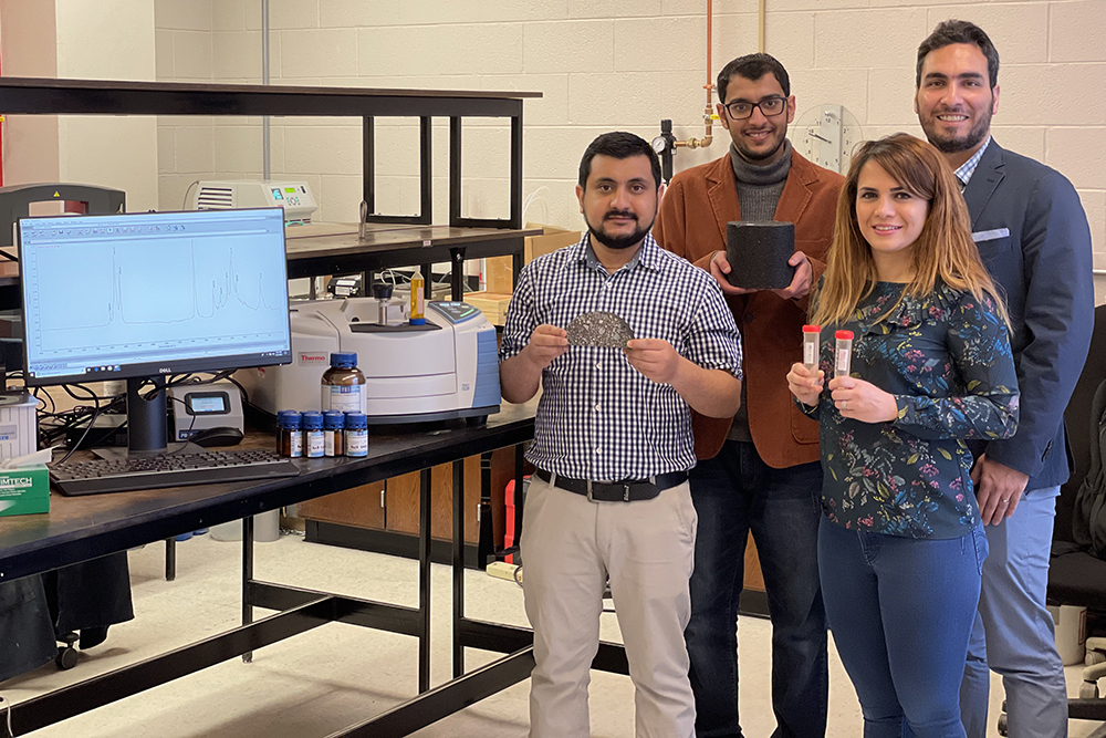 UNL's Dr. Hamzeh Haghshenas (far right) and the team of Nebraska researchers and engineers working on the asphalt project. (Photo by Nebraska Soybean Board)