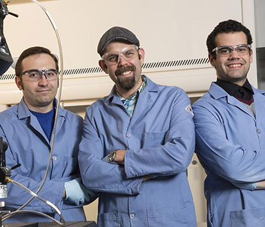 UNL researchers - (from left) Christos Argyropoulos, assistant professor of electrical and computer engineering; Stephen Morin, assistant professor of chemistry; and Jay Taylor, graduate student in chemistry - have developed a method for crafting elastic materials with a matte appearance that become highly reflective when stretched.